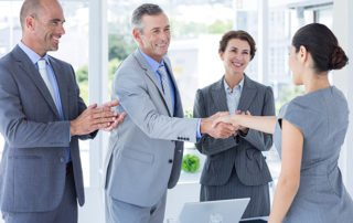 Interviewing for soft skills. P panel shaking hands with applicant in the office