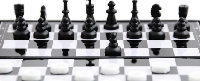 Checkers against chess-Playing Culture Games-Black chess against white checkers on the board