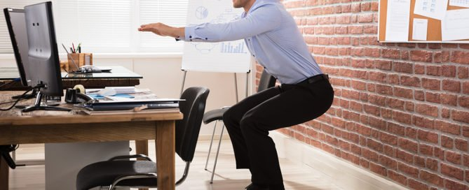 Nesso-Move-Exercise-Happy Businessman Doing Exercise In Front Of Computer At Office